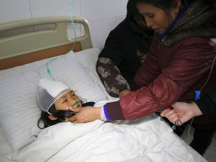 A woman holds a mobile phone for her niece to chat