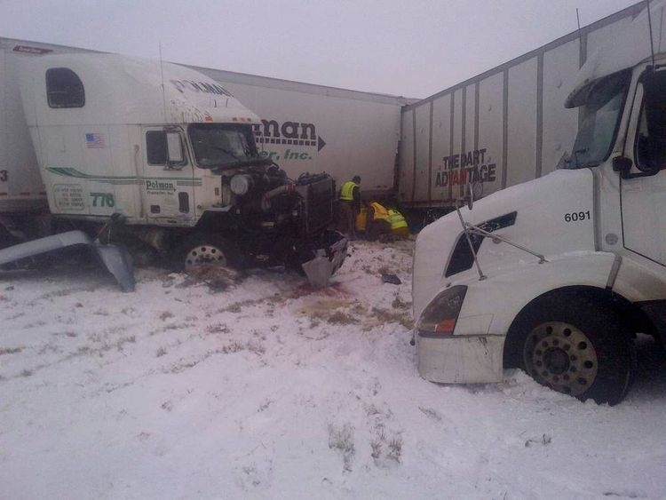 Emergency personnel work on scene after an accident on Interstate 35 near Hamilton/Wright County line in Iowa