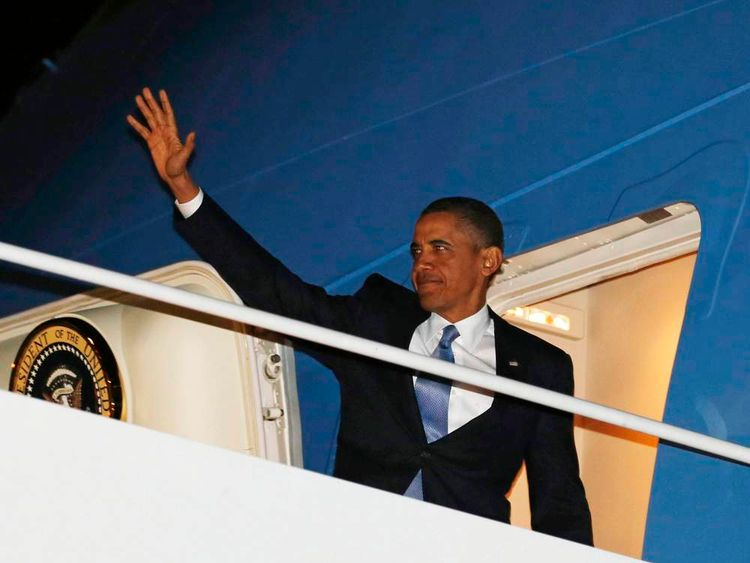 U.S. President Obama boards Air Force One outside Washington to return to Hawaii and his new year's holiday
