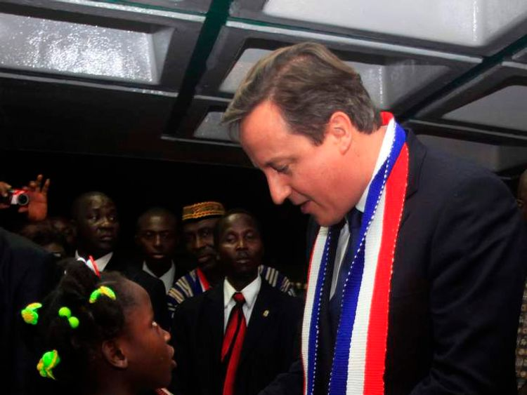 David Cameron receives a gift from a Liberian girl