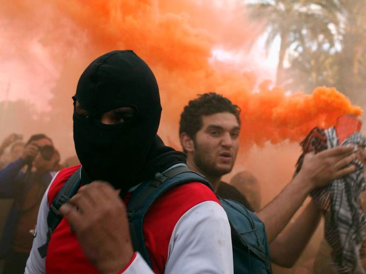 Protesters chant anti-Morsi slogans during a protest in front of the presidential palace in Cairo