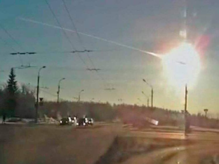 Trail of a meteorite crossing the early morning sky above the city of Kamensk-Uralsky