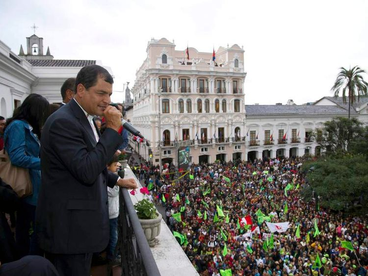 Ecuador's President Correa addresses his supporters from a balcony of Carondelet Palace in Quito