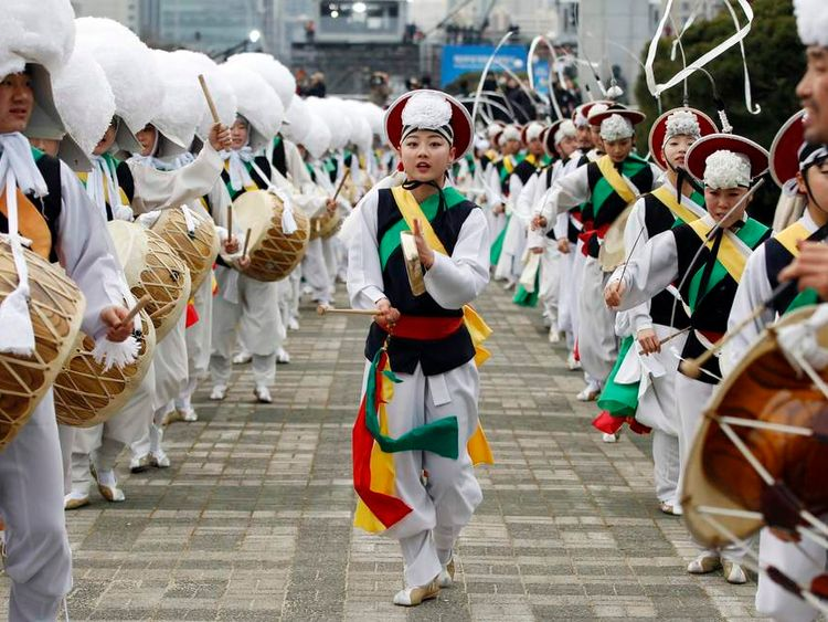 "Members of a ""Samulnori"" dance troupe, or traditional South Korean percussion assemble, perform during the inauguration of South Korea's new President Park Geun-hye at parliament in Seoul"