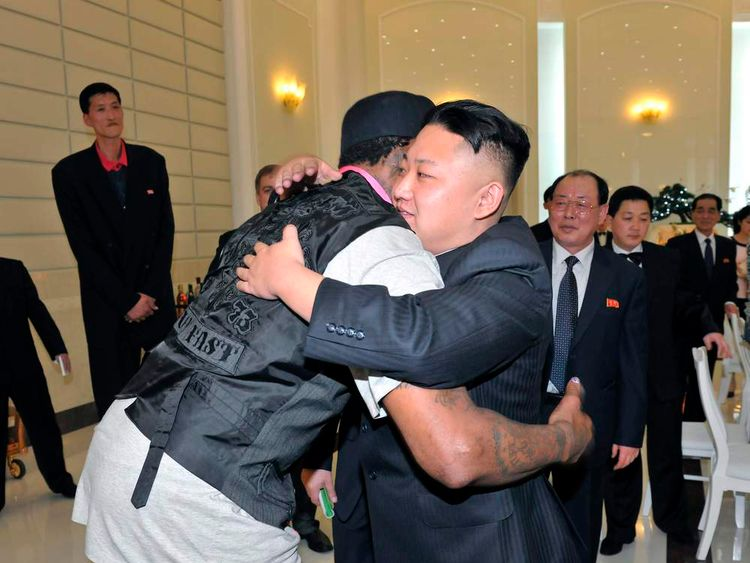 North Korean leader Kim Jong Un and former NBA basketball player Dennis Rodman hug in Pyongyang