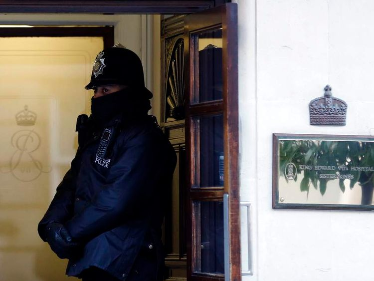 A police officer stands outside King Edward VII Hospital in central London