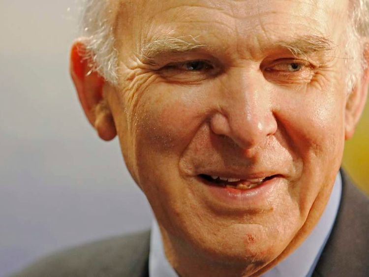 Britain's Business Secretary Vince Cable tours exhibition stands during the Liberal Democrats spring conference in Brighton