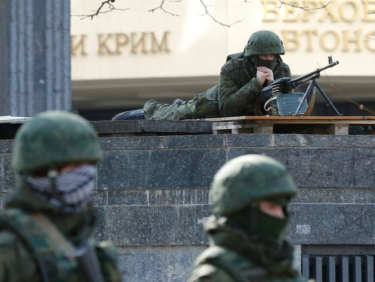 Armed men take up positions around the regional parliament building in the Crimean city of Simferopol