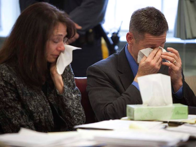 Sean and Elizabeth Canning cry during a hearing in a lawsuit brought by their daughter Rachel Canning in Morristown