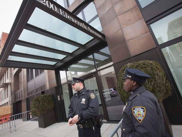 Police stand guard outside designer L'Wren Scott's home in the Manhattan borough of New York