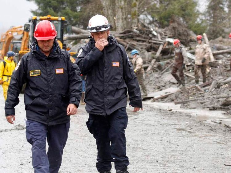 Rescue workers at the scene of a mudslide in Oso, Washington state