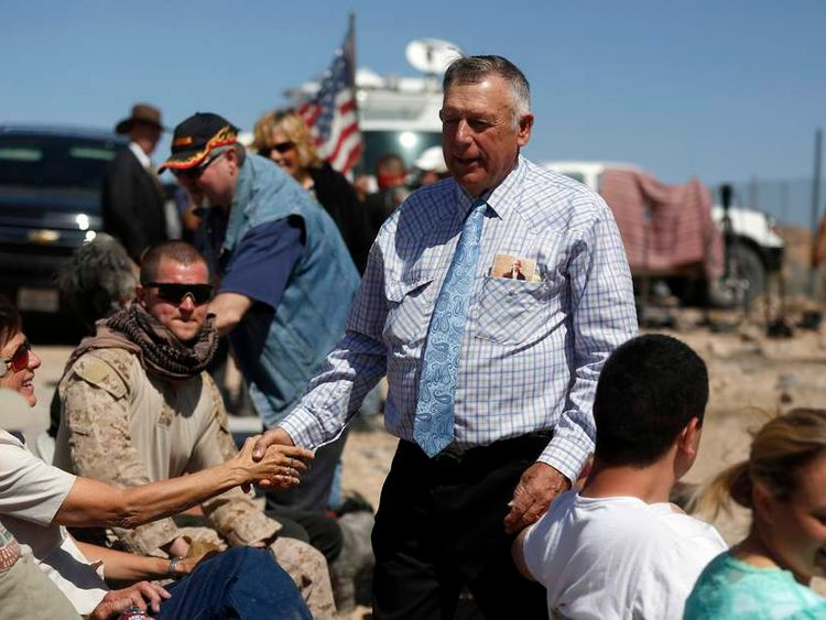 Rancher Cliven Bundy greets supporters before a roadside church service at a protest site in Bunkerville