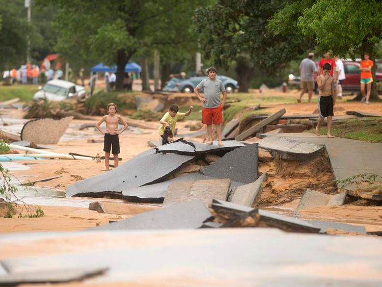 Residents survey flood damage to the Cordova Park neighborhood in Pensacola, Florida