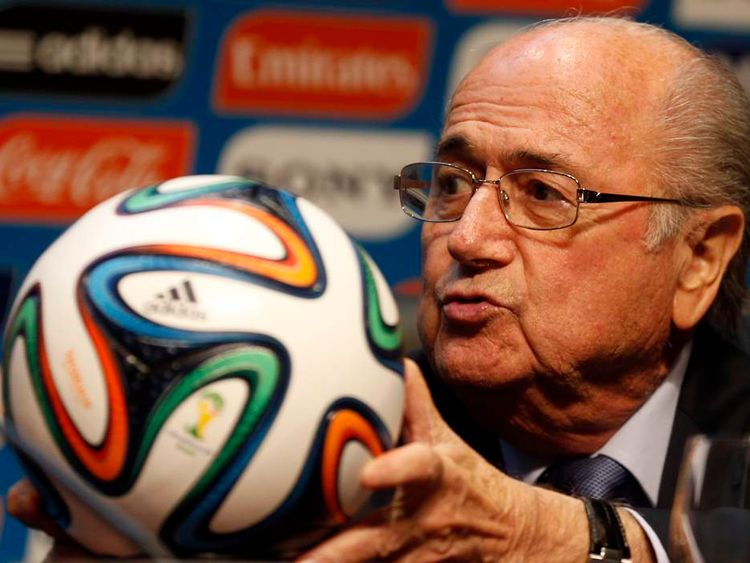 FIFA President Blatter holds an official 2014 FIFA World Cup soccer ball during a media conference in Sao Paulo