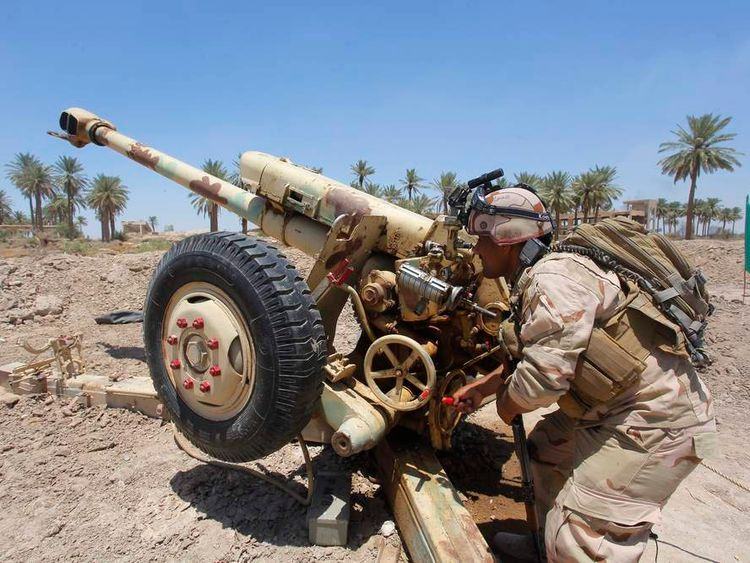 Iraqi security forces fire artillery during clashes with Sunni militant group Islamic State of Iraq and the Levant in in Jurf al-Sakhar.