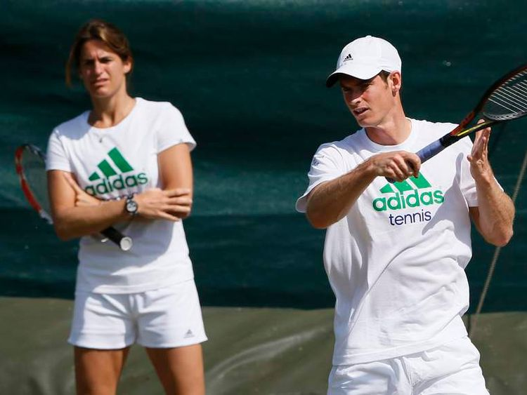 Andy Murray of Britain is watched by Amelie Mauresmo, his newly appointed coach, during a training session the day before the start of the Wimbledon Tennis Championships, in Londo