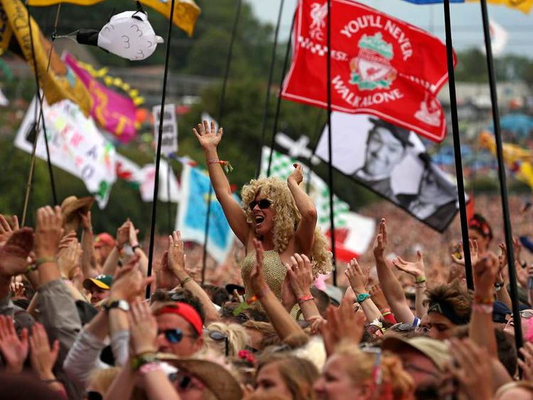 Festival goers watch Dolly Parton perform on the Pyramid Stage at Worthy Farm in Somerset, during the Glastonbury Festival