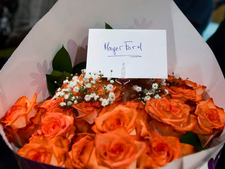 Flowers left for Toronto Mayor Rob Ford are seen after he arrived at City Hall in Toronto