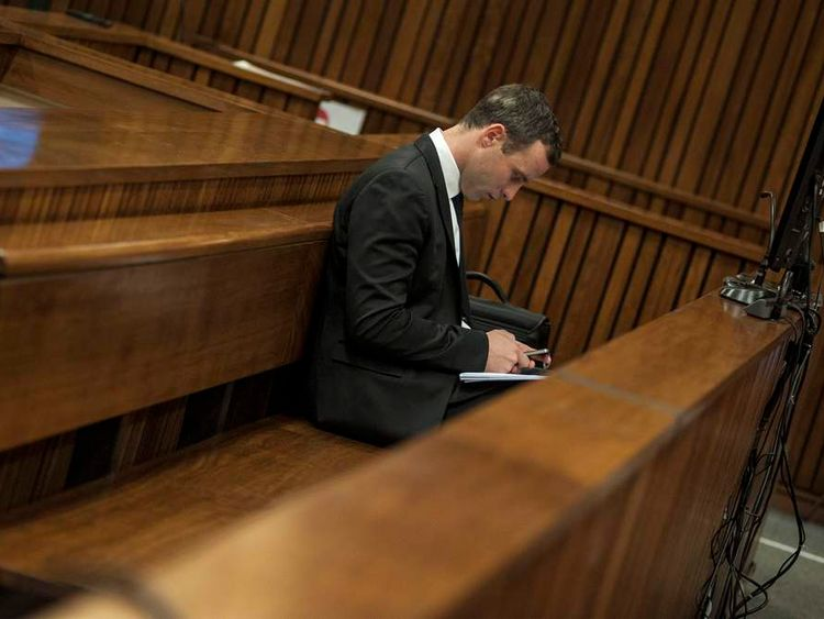 Olympic and Paralympic track star Pistorius attends his trial at the North Gauteng High Court in Pretoria.
