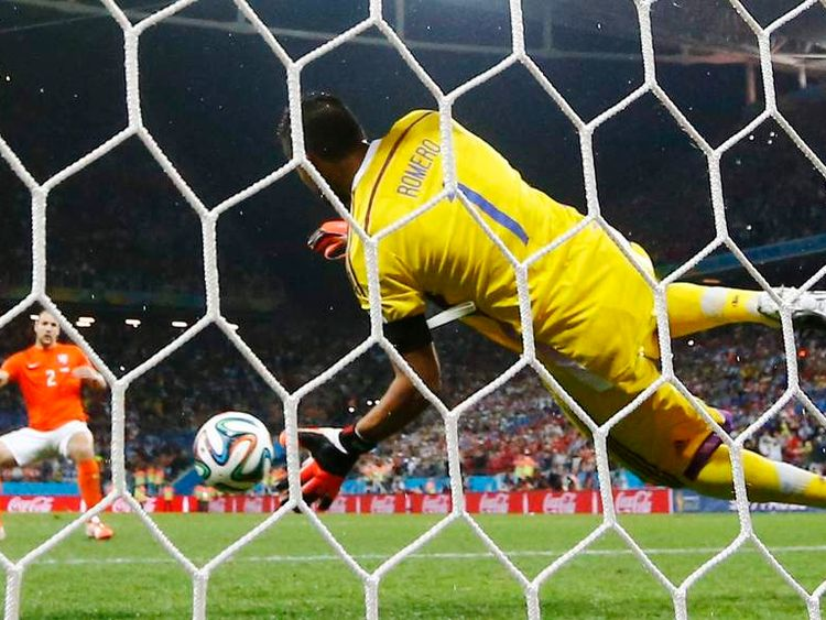 Argentina's Romero saves the penalty of Vlaar of the Netherlands during their shootout in their 2014 World Cup semi-finals at the Corinthians arena in Sao Paulo