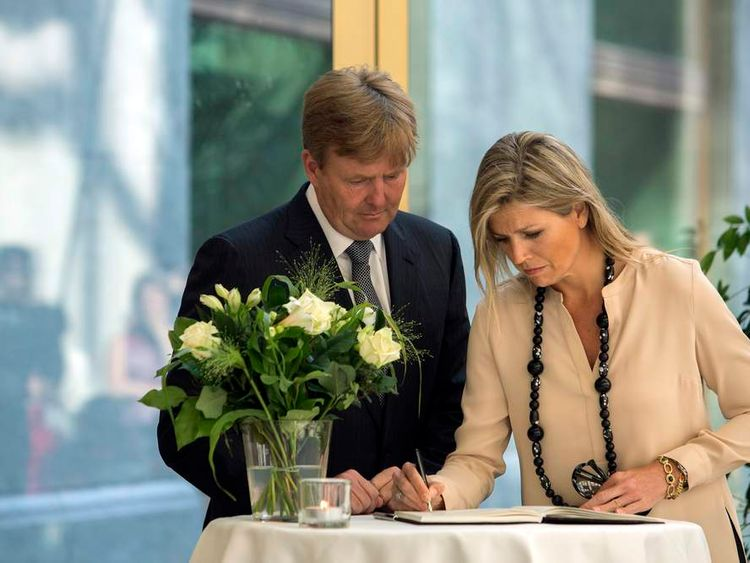 King Willem-Alexander and Queen Maxima of the Netherlands sign a condolence book for victims of the Malaysia Airlines Flight MH17 at The Hague