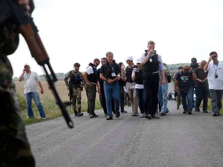 Air crash investigators arrive at the wreckage of Malaysia Airlines flight MH17 in Grabovo, eastern Ukraine