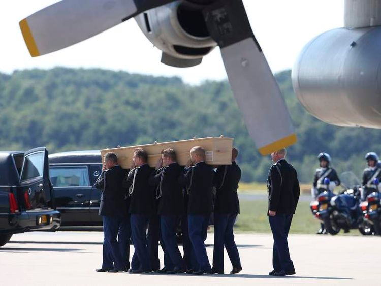 A coffin of one of the victims of Malaysia Airlines MH17 downed over rebel-held territory in eastern Ukraine, is carried from an aircraft during a national reception ceremony at Eindhoven airport