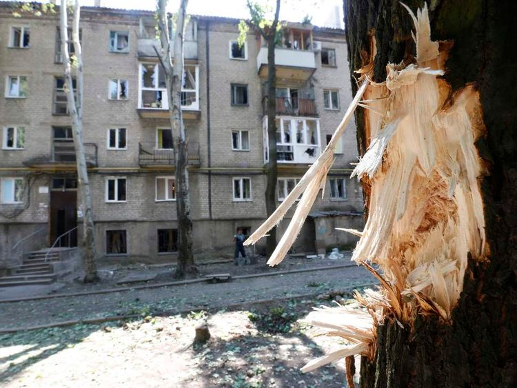 A view of a residential building damaged during what local residents say was recent shelling in Donetsk