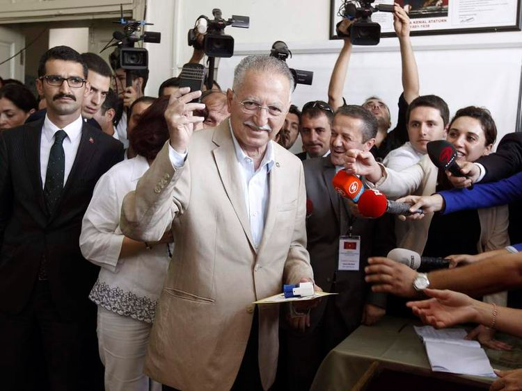 Turkish main opposition presidential candidate Ihsanoglu gestures at a polling station