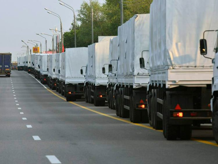 A Russian convoy of trucks carrying humanitarian aid for Ukraine stops along a road in the city of Voronezh
