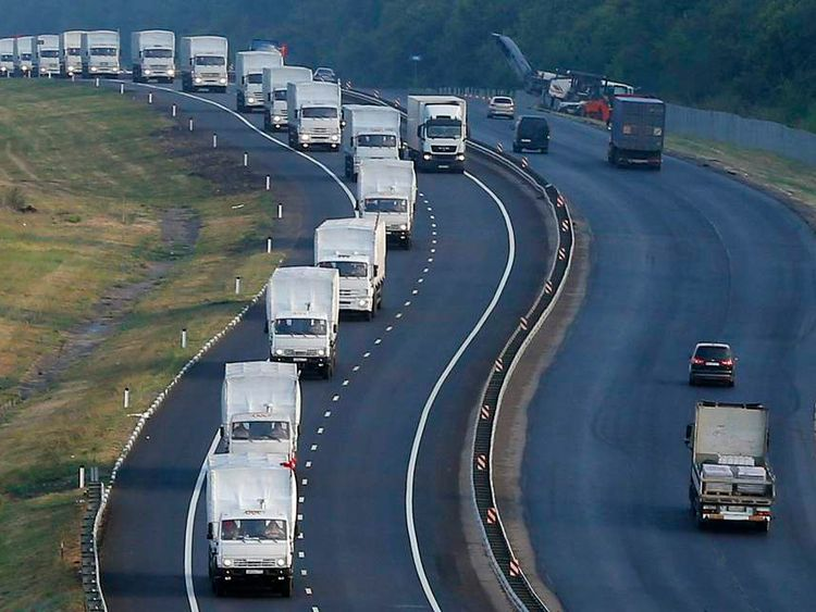 A Russian convoy of trucks carrying humanitarian aid for Ukraine travels along a road south of the city of Voronezh