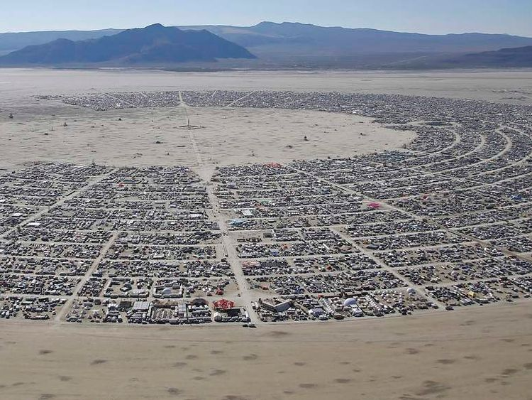 "An aerial view during the Burning Man 2014 ""Caravansary"" arts and music festival in the Black Rock Desert of Nevada"