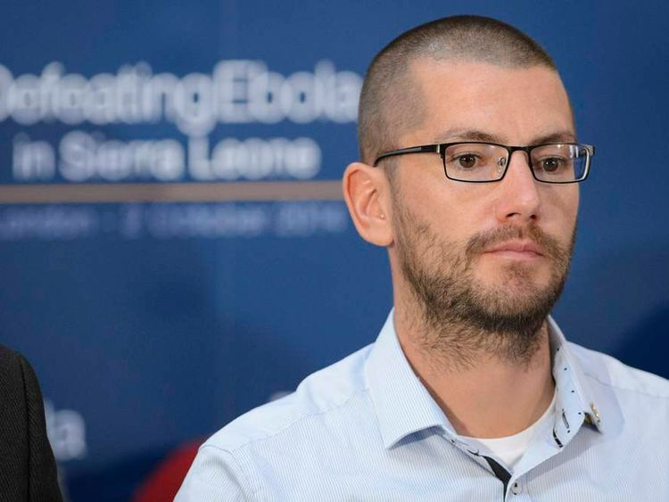 """British Ebola survivor William Pooley listens to speakers during the """"Defeating Ebola: Sierra Leone"""" conference in central London"""
