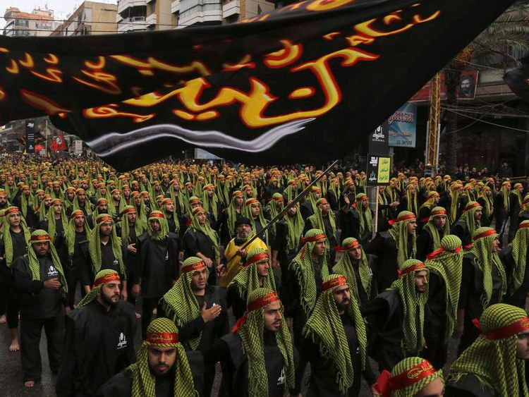 Lebanese Hezbollah supporters march during a religious procession to mark Ashoura in Beirut's suburbs
