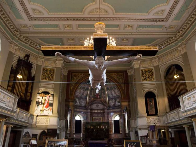 The work 'For Pete's Sake', a life size sculpture of a musician Pete Doherty crucified, hangs from the ceiling at St Marylebone Parish church in London