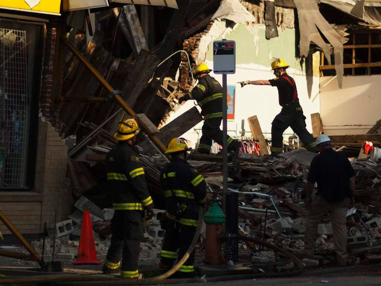 Firefighters search through rubble following a building collapse in Philadelphia