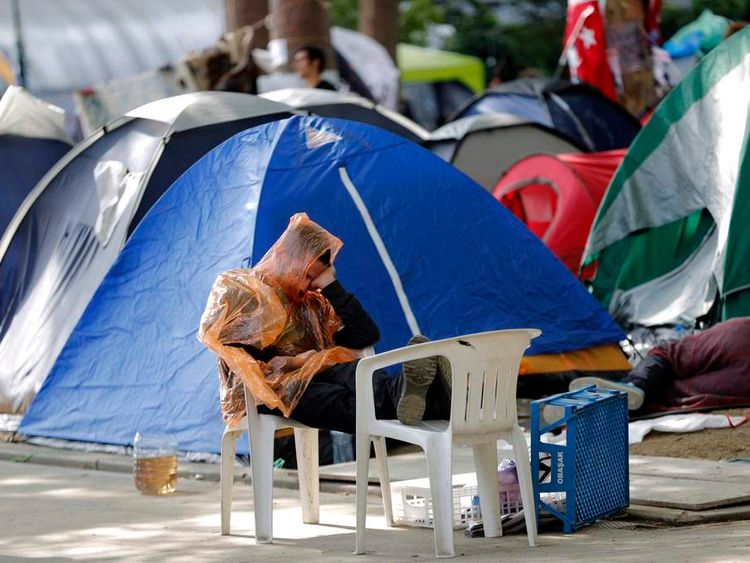 A protester sleeps in Gezi park in Istanbul's Taksim square