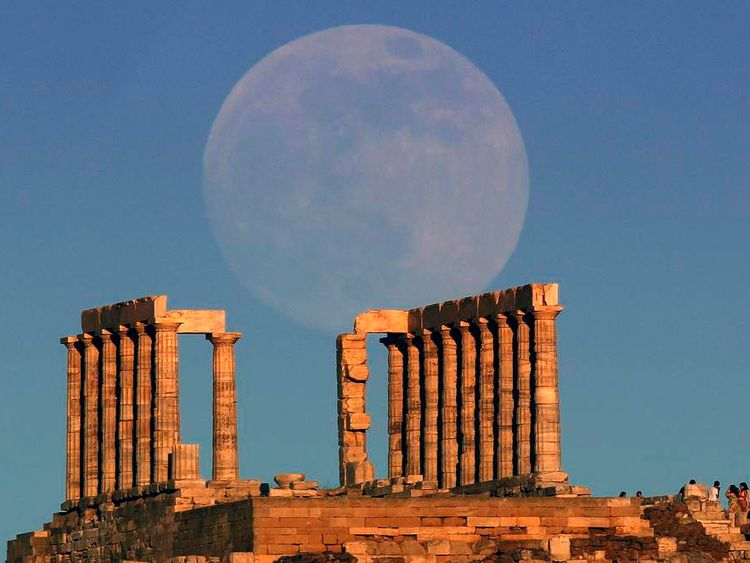 The moon rises over the temple of Poseidon