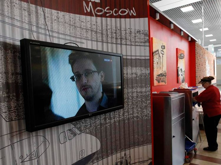A television screens the image of former U.S. spy agency contractor Edward Snowden during a news bulletin at a cafe at Moscow's Sheremetyevo airport
