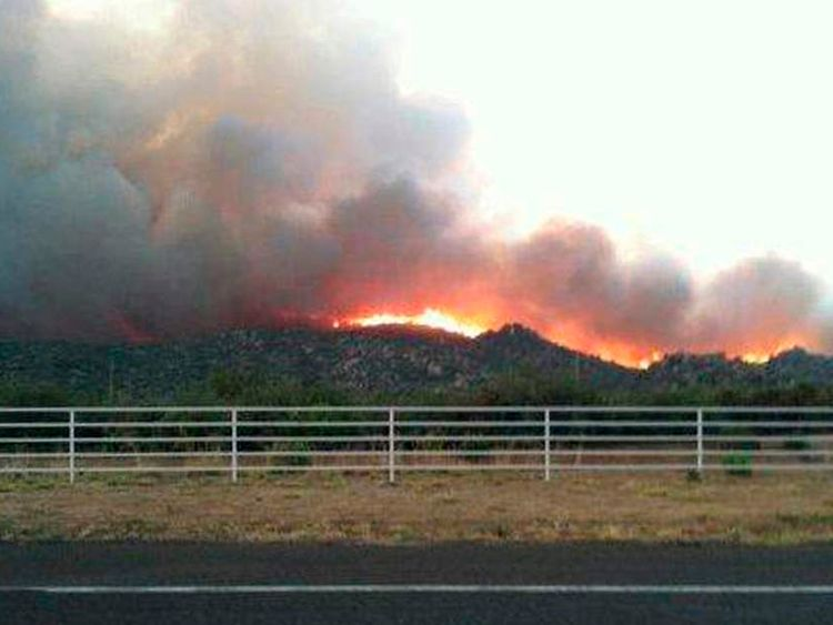 The Yarnell Hill fire is seen burning in this view from Highway I-17 near Yarnell, Arizona