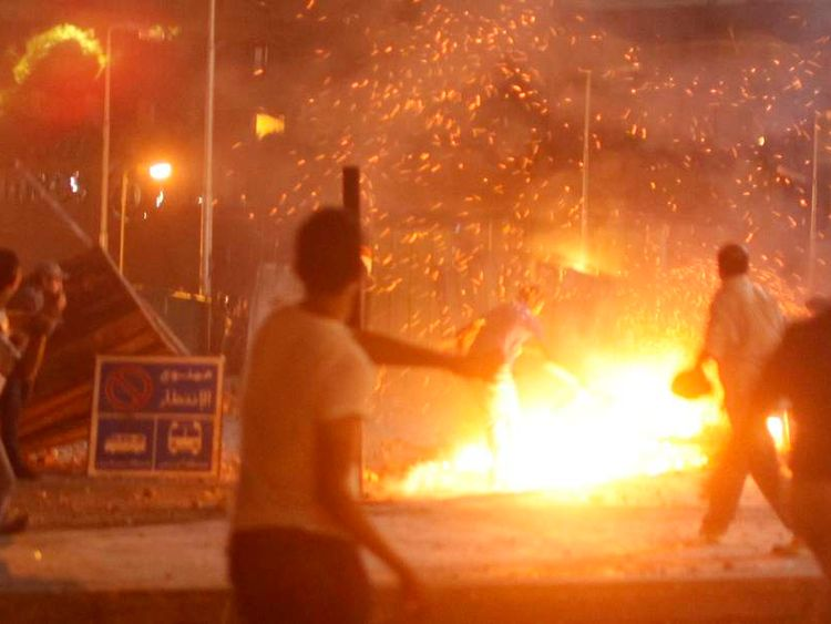 Anti-Morsi protesters clashed with supporters in Cairo on Friday night.
