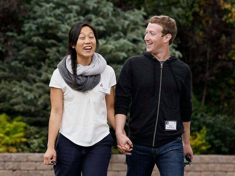 Facebook CEO Zuckerberg walks with wife Priscilla Chan at the annual Allen and Co. conference at the Sun Valley