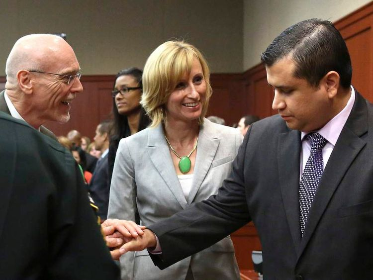 George Zimmerman is congratulated by his defence team after being found not guilty in the shooting death of Trayvon Martin at the Seminole County Criminal Justice Center in Sanford Florida