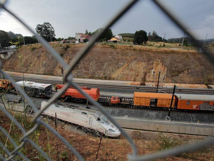 The wrecked train engine is seen at the site of a train crash in Santiago de Compostela