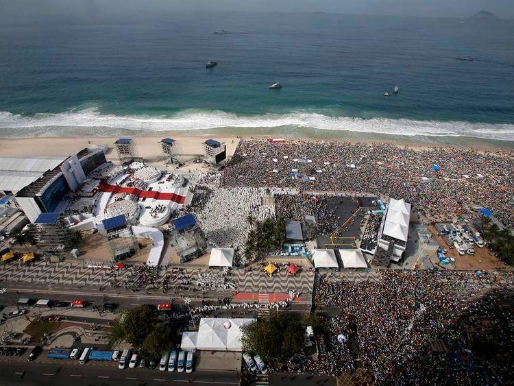 Catholic faithful gather for Pope Francis' final mass on Copacabana Beach in Rio de Janeiro
