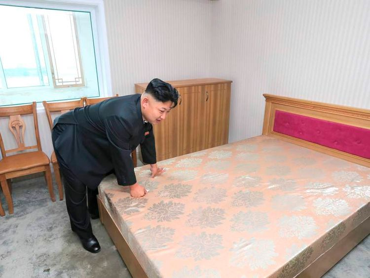 North Korean leader Kim Jong-un inspects the construction site of the apartment houses for scientists close to completion in this undated photo released by North Korea's Korean Central News Agency (KCNA) in Pyongyang