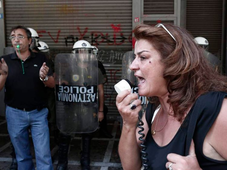 Protesters from the state social insurance funds shout slogans during a rally outside the labour ministry in Athens