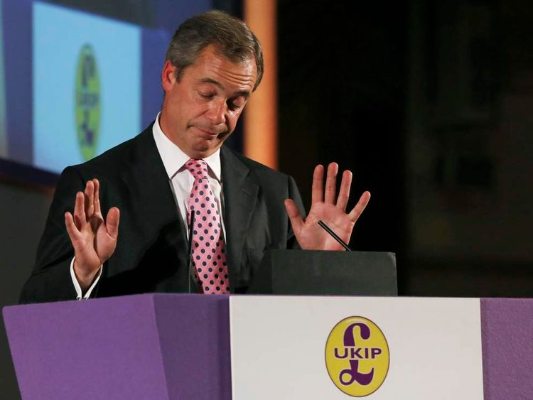 The leader of the UK Independence Party, Nigel Farage, speaks after an announcement by party chairman Steve Crowther that the party whip is to be withdrawn from Godfrey Bloom, at the party's annual conference in London