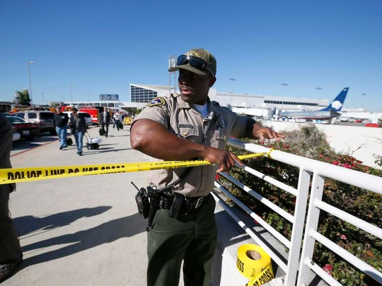 Airport police officer cordons off terminals 2 and 3