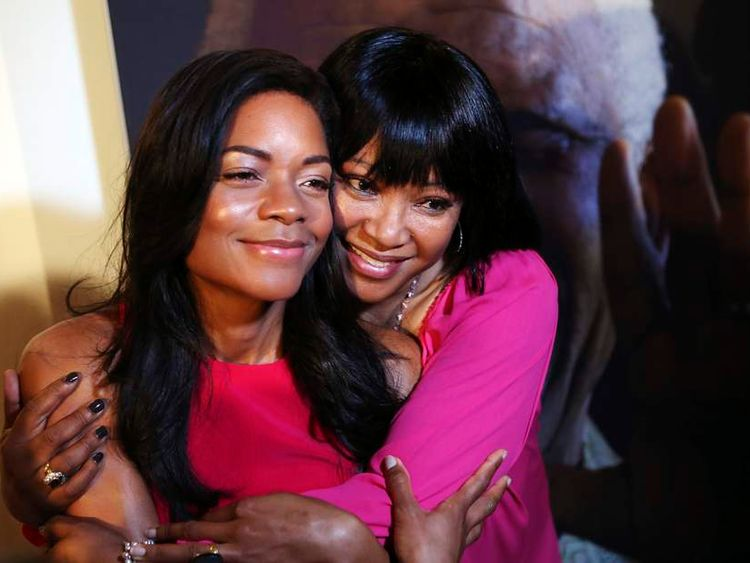 "Cast member Naomie Harris poses with Zindzi Mandela at the end of a news conference for ""Mandela: Long Walk to Freedom"" in Johannesburg"